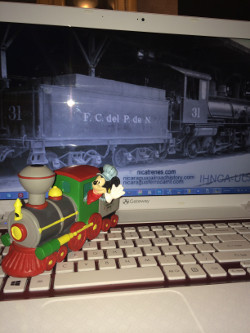 Micky mouse in a steam locomotive with my laptop